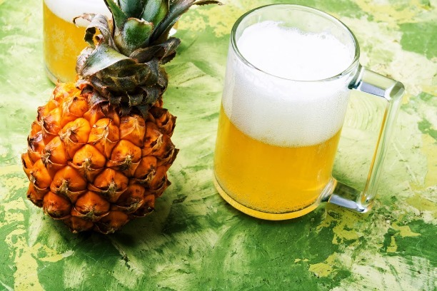 Glass with eya with pineapple flavor. Pineapple alcoholic ale.