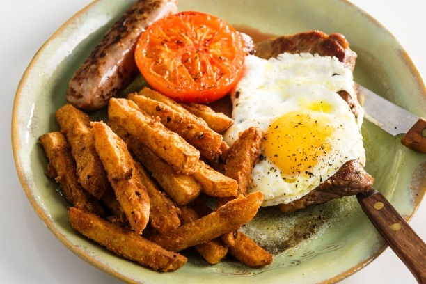 Breakfast for champions – spicy chips served with steak, sausage, and fried egg00006
